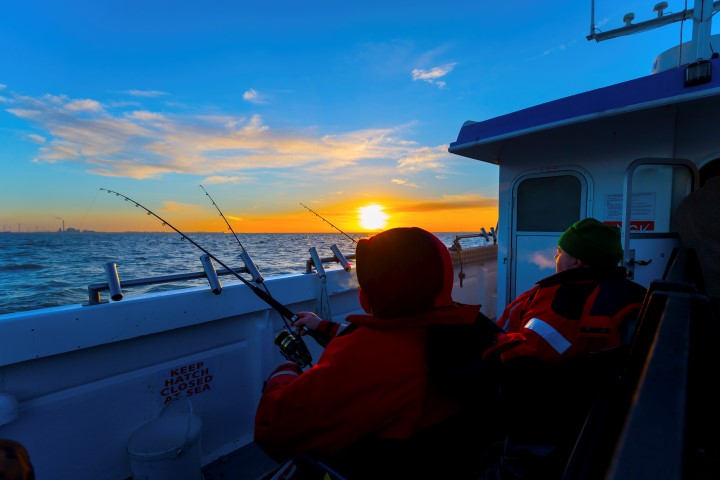 Fishing from a charter boat on a cold winter day